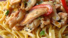 Cajun Chicken Pasta: Chicken dredged in Cajun spices is sauteed with bell peppers and mushrooms, and presented in a basil-cream sauce over linguine.