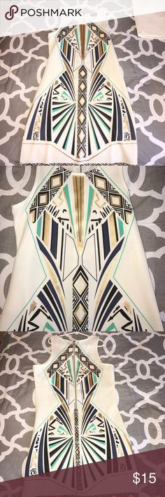 A cream going out dress with Aztec design! This dress is a fitted! Probably would go up one size from what you usually wear. Perfect condition! Aztec design in gold really shines! Dresses Mini