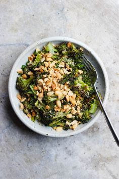 Charred Broccoli with Soy Peanut Sauce | Charred broccoli with soy peanut sauce, tossed with parsley and crushed peanuts on top. Charred broccoli with soy peanut sauce that's gluten-free + vegan.