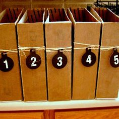 Postal boxes turned organizers ... Have to do this but hanging names not numbers