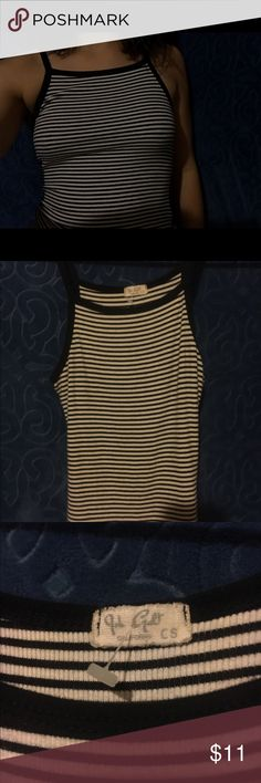 black and white tank top / Brandy Melville A black and white tank top, very stretchy and comfortable material. The item has been worn once Brandy Melville Tops Tank Tops