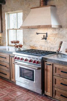 The existing stone wall backsplash, one of the kitchen's vintage and distinctive features, was retained.