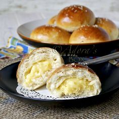 Easiest custard (for custard buns) 10 egg yolks 2 c. condensed milk 1/4 c. butter 2 tsps. vanilla Mix the egg yolks, condensed milk, butter and vanilla in a saucepan. Cook on low heat, while constantly stirring, until thick. Leave to cool. Use as filling for the buns. Recipe for the buns too.