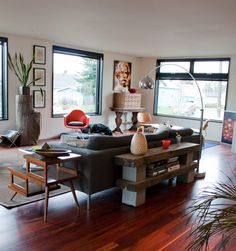 love the wood and cinder block table behind the couch!!