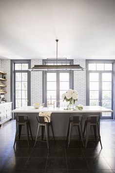 kitchen with white subway tiles, dark grout and black window frames