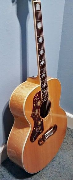 http://www.ebay.com/itm/Gibson-SJ-200-Acoustic-Natural-Quilted-Maple-Left-Handed-/261743401944?pt=Guitar
