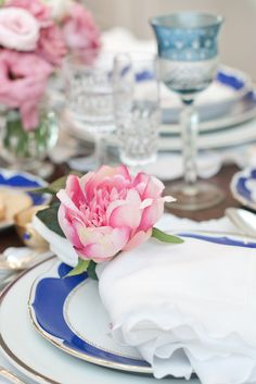 Set the table in blue and pink.