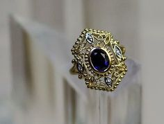 14k sapphire ring with diamond accents.