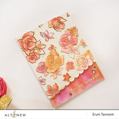 Amazing You floral stamps heat embossed in gold and watercolored with tones of coral, pink, and peach. www.altenew.com