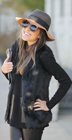 For a chic fall look, go all black with a faux fur vest for a hit of texture.
