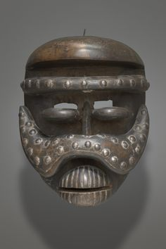 Mask late 19th to early 20th century Wood, brass tacks, and pigment Object: 26 x 19 x 14.5 cm (10 1/4 x 7 1/2 x 5 11/16 in.) Charles B. Benenson, B.A. 1933, Collection 2006.51.167 Geography: Made in Guinea Coast, Liberia Made in Guinea Coast, Ivory Coast Culture: Bété
