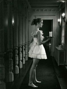 Model is wearing a shortie 'pinafore' nightgown, photo by Nina Leen, 1957