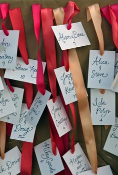 Escort cards tied to ribbons and pinned to boards (Ingalls Photo)