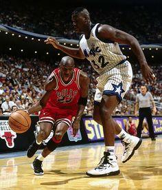 """Michael Jordan dribbling past Shaq in the Nike Air Jordan XI """"Space Jam"""""""