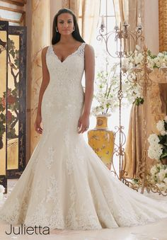 Wedding Dresses By Julietta featuring Embroidered Lace Appliques on Tulle with…