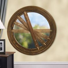 Rotary Window.  This stylish circular wood window can be opened to the precise degree desired—and there's no protruding sash. This enhanced photograph of the Rotary window demonstrates how the sash rotates to open the window.
