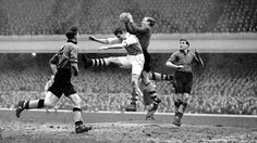 Wolves keeper Bert Williams catches the ball under pressure from Arsenal's Doug Lishman