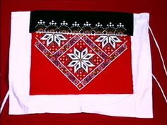 A Norwegian beaded bringeklut (breast piece for a bunad).  This is very similar to mine.