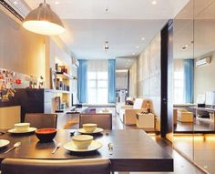 Apartment, Two White Arm Chairs White End Table With Storage Small Modern Coffee Table Ceiling Lights Wall Bookshelves Blue Window Curtain Hardwood Dining Table With Black Chairs Ikea Pendant Lamp: Interesting Design of Very Small Apartment And Photos