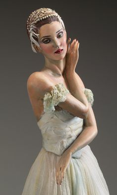 White Swan by Nancy Wiley  Acrylic paint over cast resin.