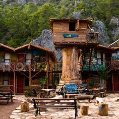 """Olympos, Turkey """"European hostel"""" and """"interesting design"""" are two phrases that don't usually get uttered in the same sentence. But these Kadir Treehouse Hostels break free of the bureaucratic-office-building stereotype with Western-themed log-cabin construction and wagon-wheel decorations."""