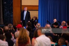 Republican presidential candidate Donald Trump steps onto the stage before introducing his vice presidential running mate Indiana Gov. Mike Pence at the New York Hilton Midtown on July 16, 2016 in New York City. Trump announced his choice on Friday via Twitter after the initial press conference was canceled due to the terrorist attack in Nice, France.