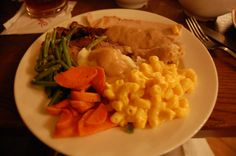 Liberty Tree Tavern Patriot's Platter - Roasted turkey breast, carved beef, and sliced pork, with mashed potatoes, seasonal vegetables, herb bread stuffing, and Macaroni and Cheese.  This is served in big bowls to your table and you fix your plate :)