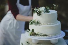 simple white wedding cake with floral accents | Ray + Kelly Photography