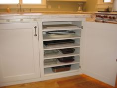Shelves in cabinet so you don't have to constantly unstack cooking pans