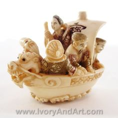 An extremely amazing Mammoth ivory Netsuke of  Japans' Seven Gods of Fortune Sailing in a Dragon Head Boat.