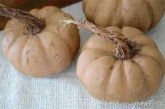Use this tutorial to turn inexpensive plastic pumpkins into realistic looking decorations using a little paint and sisal rope! anderson and grant Pumpkin Topiary, Pumpkin Stem, Diy Pumpkin, Pumpkin Crafts, Cute Pumpkin, Fall Crafts, Pumpkin Carving, Halloween Crafts, Halloween Pumpkins