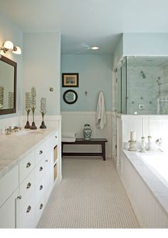 Inspiration for Master Bath - breadboard bottom half, white cabinets, marble shower with half wall/half glass