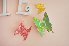 PBK {knockoff} Wall Decor  These are butterflies, but I think I could do something more our style with the same method.