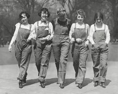 Five cheerful young c. 1920s women sporting overalls and boots. #vintage #1920s #overalls #fashion