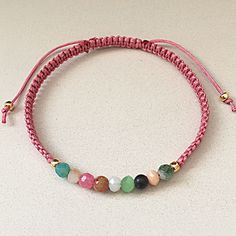 This handmade pink knotted bracelet is beautiful with it's mix of colourful…