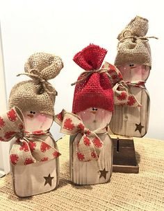Adorable rustic snowman holiday wooden decor. This primitive, yet modern looking snowman has been cut, sanded, painted, sanded again, then stained. I then embellished it with some Valentine heart ribbon. Please zoom in on all pictures. I have a batch of these little guys drying so you