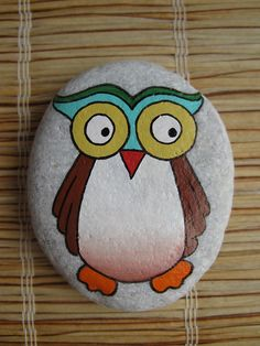 cartoon owl painted on a rock