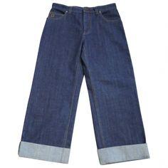 Pantalón vaquero azul cinco bolsillos de corte ancho con vuelta en el bajo, largo al tobillo. Talla 36<br /> Medidas: cintura 38cm, entrepierna 29cm, largo 87cm, ancho del bajo 23cm.