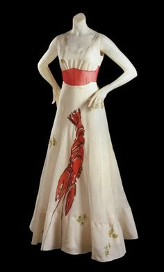 In 1937, Wallis Simpson posed for Vogue in this Schiaparelli evening gown that had a lobster printed on its skirt. Salvador Dalí designed the print, which also featured sprigs of parsley. The Vogue spread was intended to introduce readers to Mrs. Simpson, who in July of that year would marry Edward VIII, Duke of Windsor and abdicated King of England.