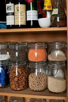 love this idea to get all those beans, nuts, rice and things into uniform containers and easy to grab because you can see them