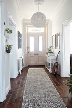 Opt for a #neutral #colour #scheme if you'd like to add a bright and spacious feel to a #small #hallway. White #walls, a large #mirror and furniture that (almost) blends in with the rest of the #scheme are great options for #maximising #space and #natural #light. For more #decorating ideas for #hallways, take a look at our feature.