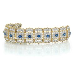 Two-Color Gold, Diamond and Sapphire Bracelet, Mario Buccellati  18 kt. yellow and white gold, the wide delicately pierced bracelet centering 12 oval sapphires approximately 8.00 cts., within squares of 96 round diamonds, flanked by 72 round diamonds, altogether approximately 20.00 cts., all within slender outlines of scalloped textured gold, signed M. Buccellati, Italy, approximately 28.3 dwt.