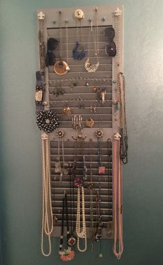 Spray a discarded shutter silver and it will shine on its own as a jewelry/accessory holder. Use a variety of hooks, knobs, pegs, etc. Even a circle chain stretched to hold earrings.