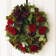 Red grand prix roses, hypericum berries, rosemary, eucalyptus and ivy berries