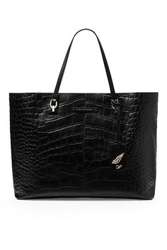 Our newest tote, the Voyage Ready to Go is practical and chic in embossed croc. Oversized with internal pockets. Suede lining. In embossed leather., $398