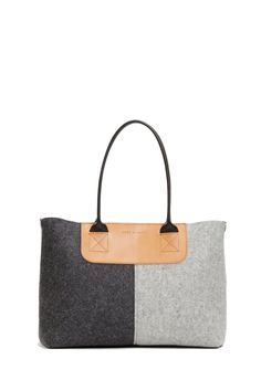 The Graf & Lantz Chadwick Petite Tote's longer strap-length and scaled-down proportions moves the Chadwick up onto your shoulder and into your busy workday. Rich merino wool felt lends texture to this
