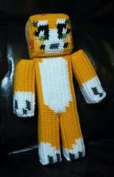 Crochet Stampycat from Minecraft. Made for my 4 year old for Christmas. I will be writing up a pattern shortly!