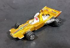 Rare 1980s Yatming McLaren Ford Shell Fuel Gold #4 No. 1304 Die Cast Toy Race Car Vehicle https://treasurevalleyantiques.com/products/rare-1980s-yatming-mclaren-ford-shell-fuel-gold-4-no-1304-die-cast-toy-race-car-vehicle #Rare #Vintage #1980s #80s #Eighties #McLaren #Fords #Shell #Fuel #Golden #DieCast #Toy #Cars #Racecars #Racing #Vehicles #Autos #Automobiles #Collectibles #FastCars