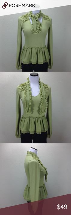 Twelve Heirloom Light Green Peplum Sweater Long Sleeve light green V-neck peplum sweater with ruffle tie and ruffle accented shoulders. In excellent condition with no visible spots, holes or piling. Thanks for your interest!  Please checkout the rest of my closet. Twelve Heirloom Sweaters