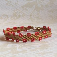 Handcrafted, Peyote Stitch, Cuff Bracelet in Gold and Red Beads Bead Loom Bracelets, Woven Bracelets, Seed Bead Patterns, Beading Patterns, Seed Bead Jewelry, Beaded Jewelry, Peyote Stitch, Loom Beading, Bracelet Patterns